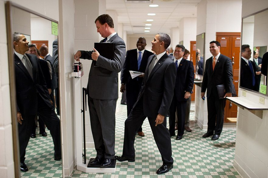 5-president-barack-obama-jokingly-puts-his-toe-on-the-scale-as-trip-director-marvin-nicholson-weighs-himself