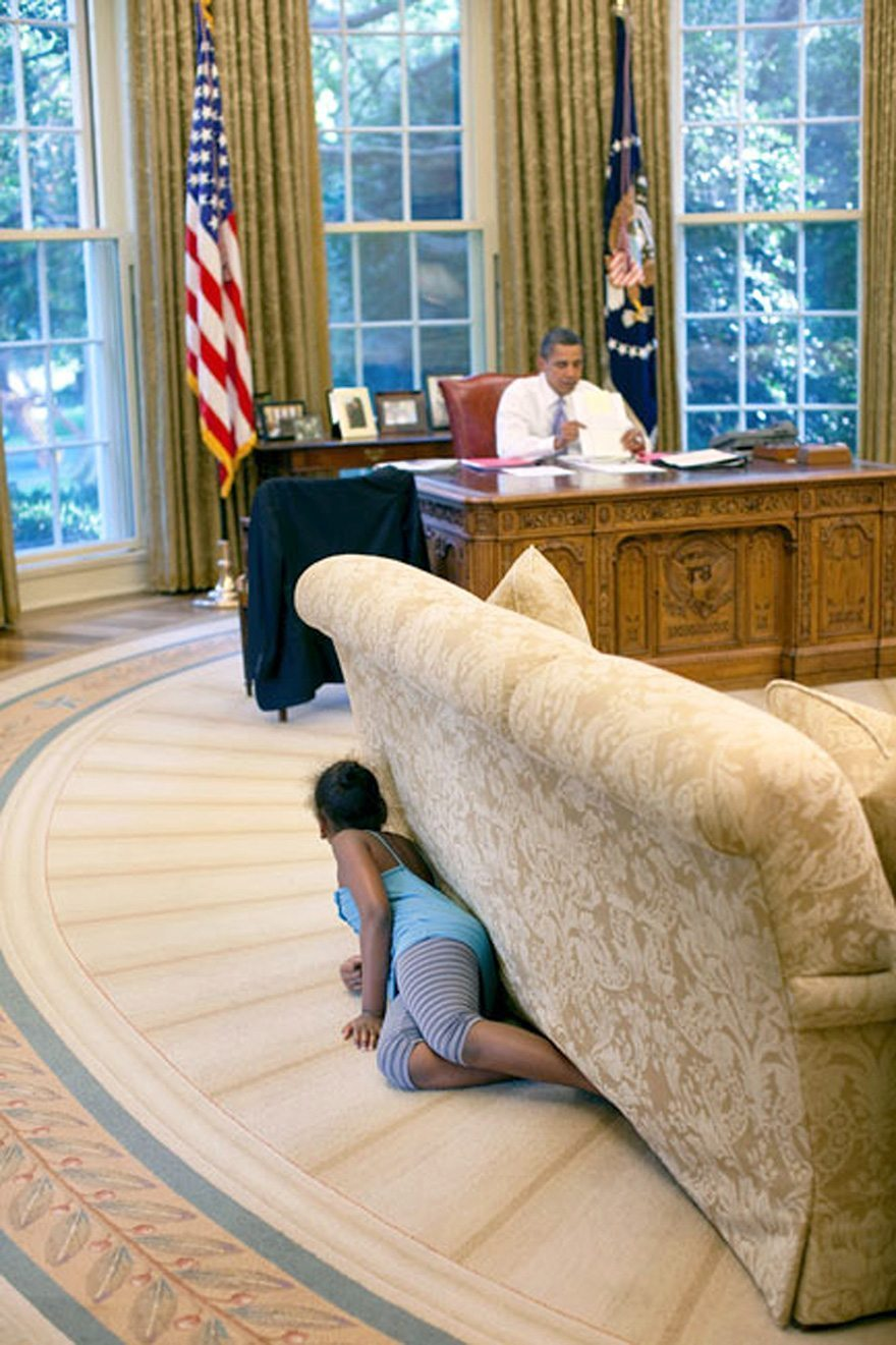 22-president-barack-obamas-daughter-sasha-hides-behind-the-sofa-as-she-sneaks-up-on-him-at-the-end-of-the-day-in-the-oval-office