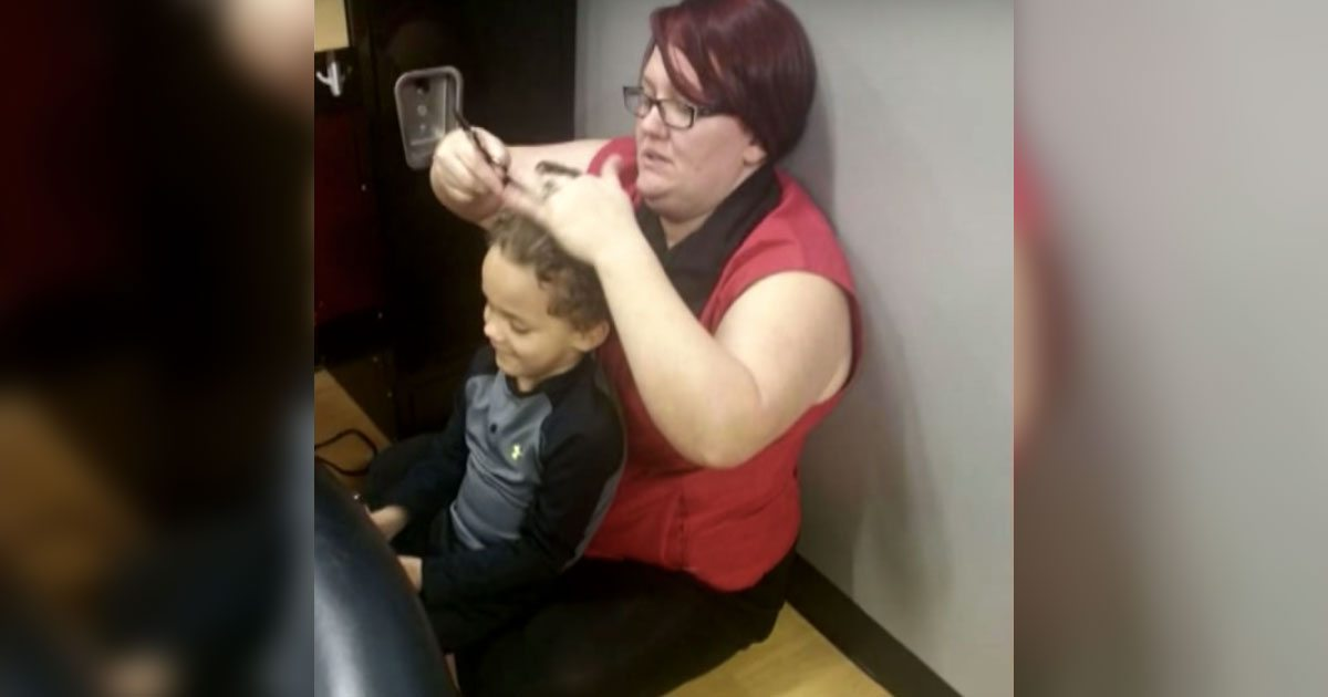 hairstylist_gives_boy_with_autism_haircut_on_floor_featured