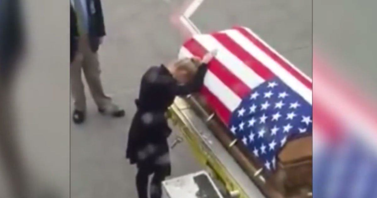 soldiers_wife_mourns_over_coffin_featured