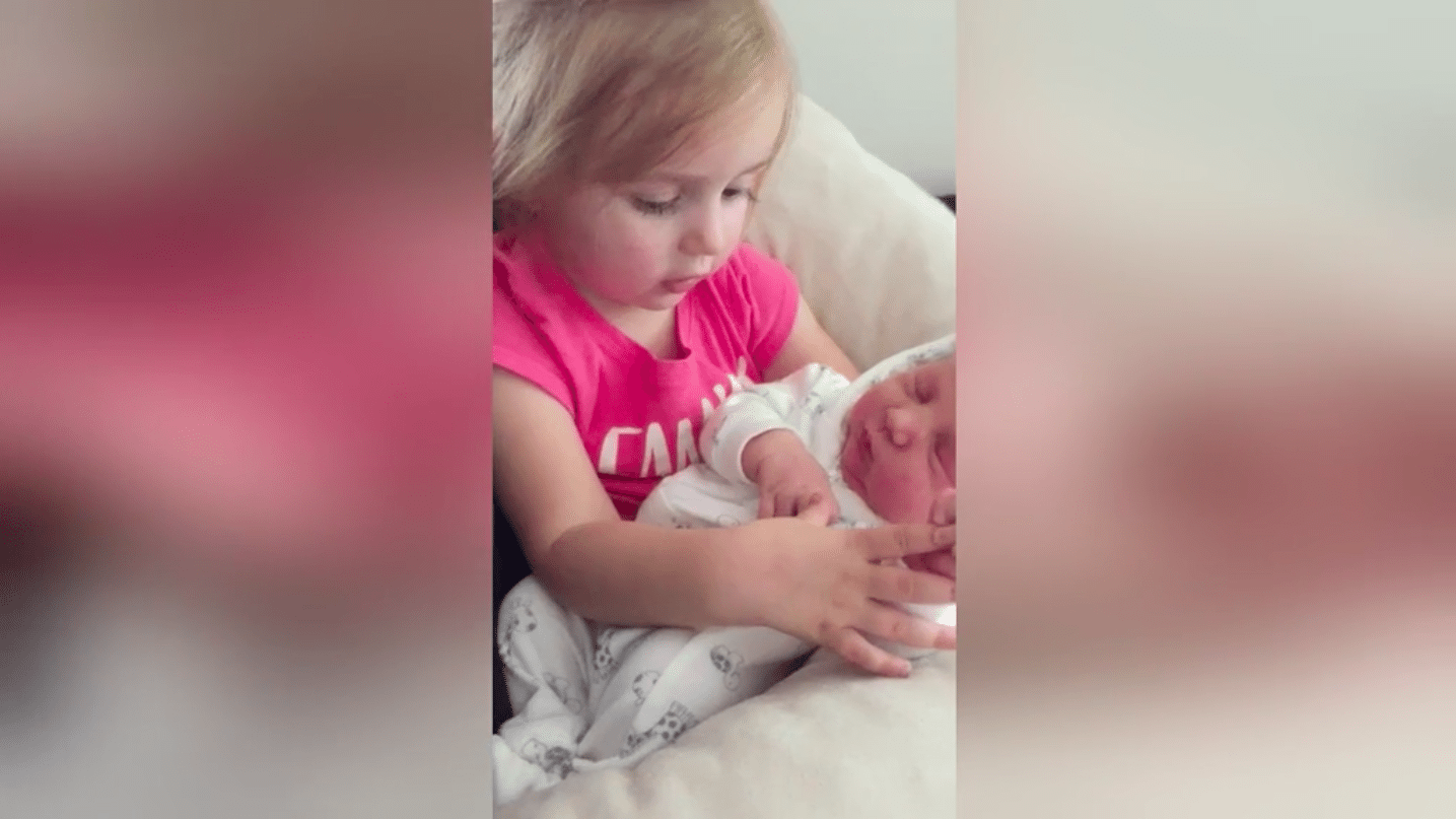 toddler sings her own lullaby to newborn sister