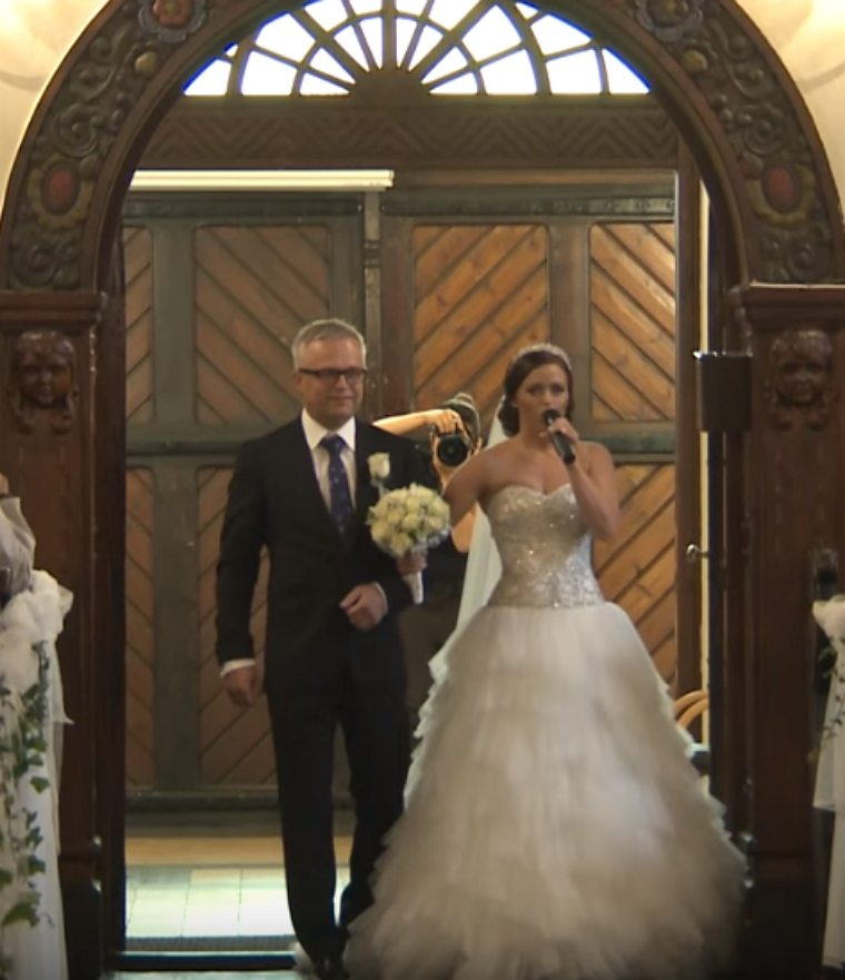 Bride Surprises Groom With A Song When Walking Down The Aisle