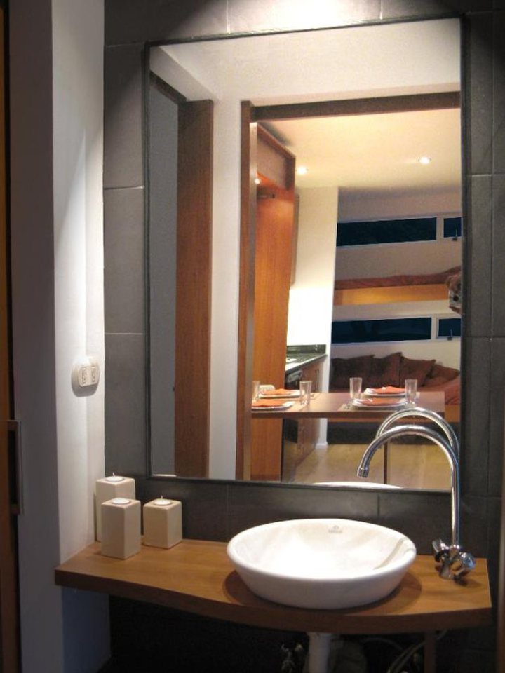 A small contemporary bathroom sits at the