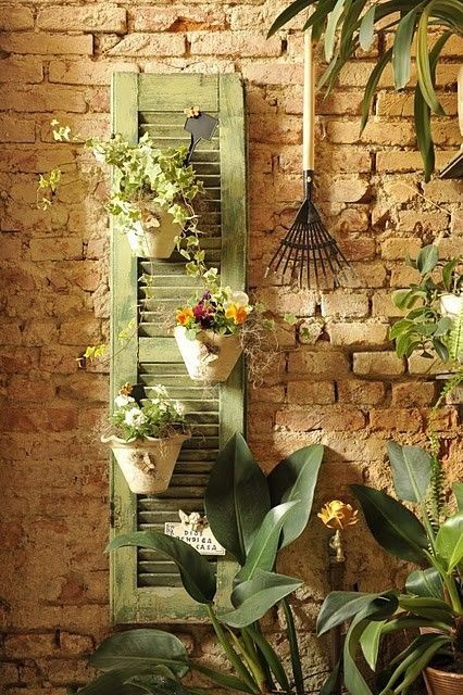 outdoor garden decor using an old wood shutter