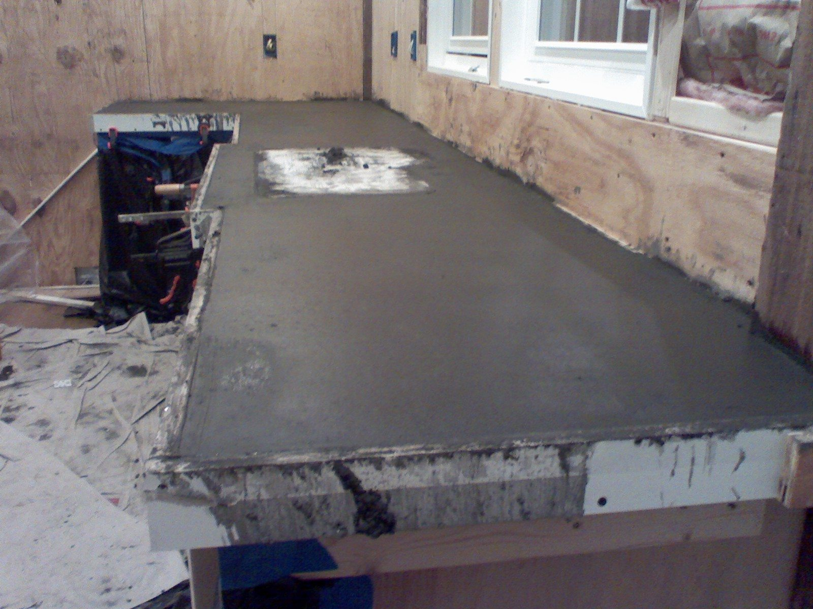 how to make DIY concrete countertops in your kitchen over laminate