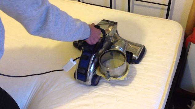 deep clean mattress with vacuum step 1