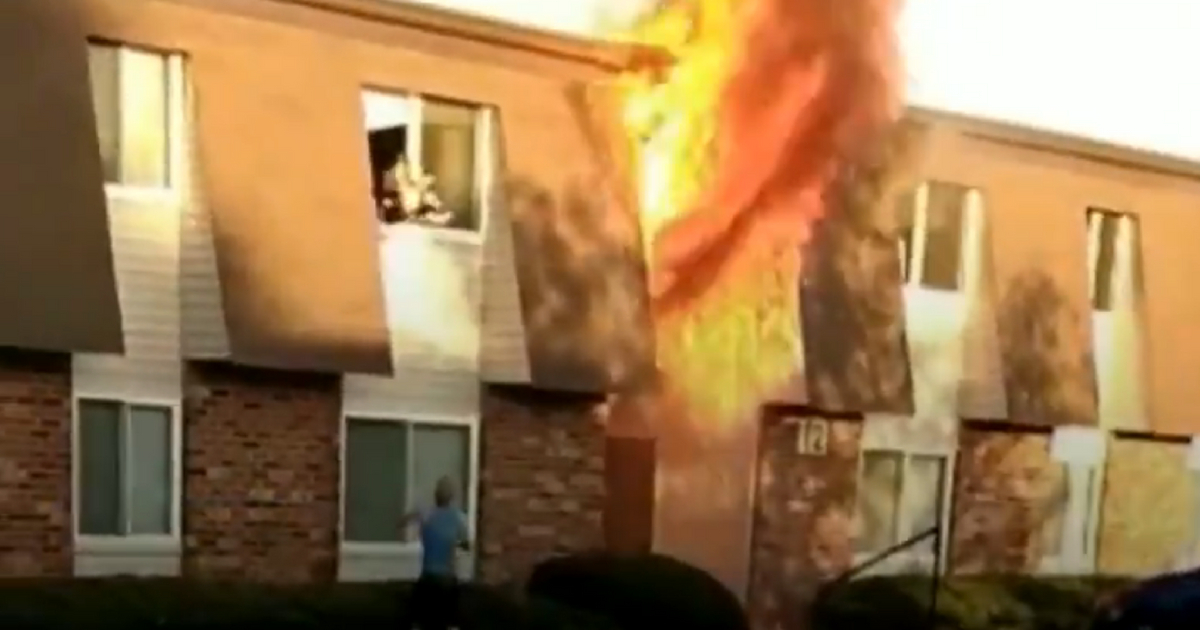 marine-catches-baby-from-window-of-burning-building