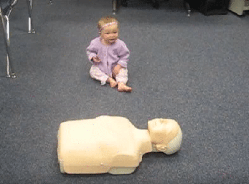 Amazing Baby Demonstrates CPR on Dummy