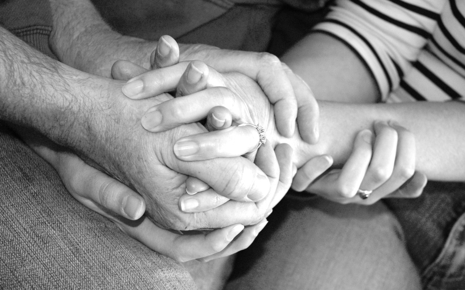 grieving-family-hands