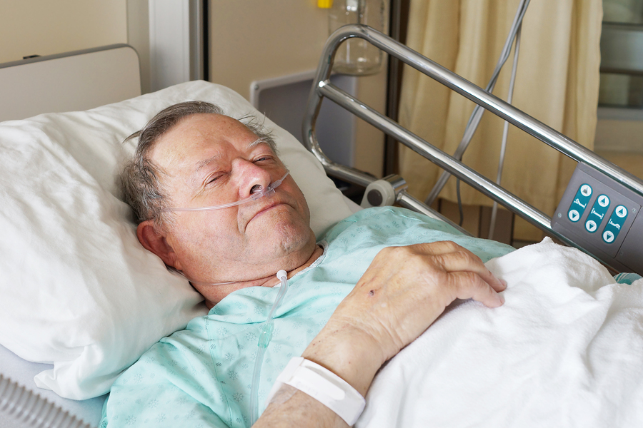 hospitalized-man-bed