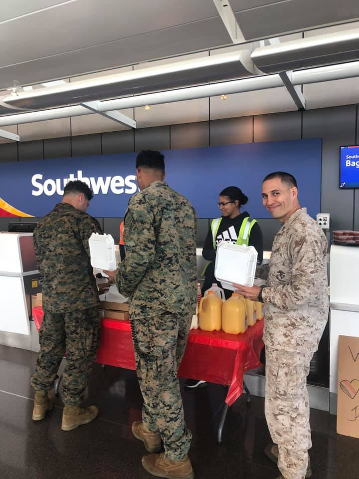 US Military Troops Taking Breakfast Turn By Turn From Southwest Airlines Booth