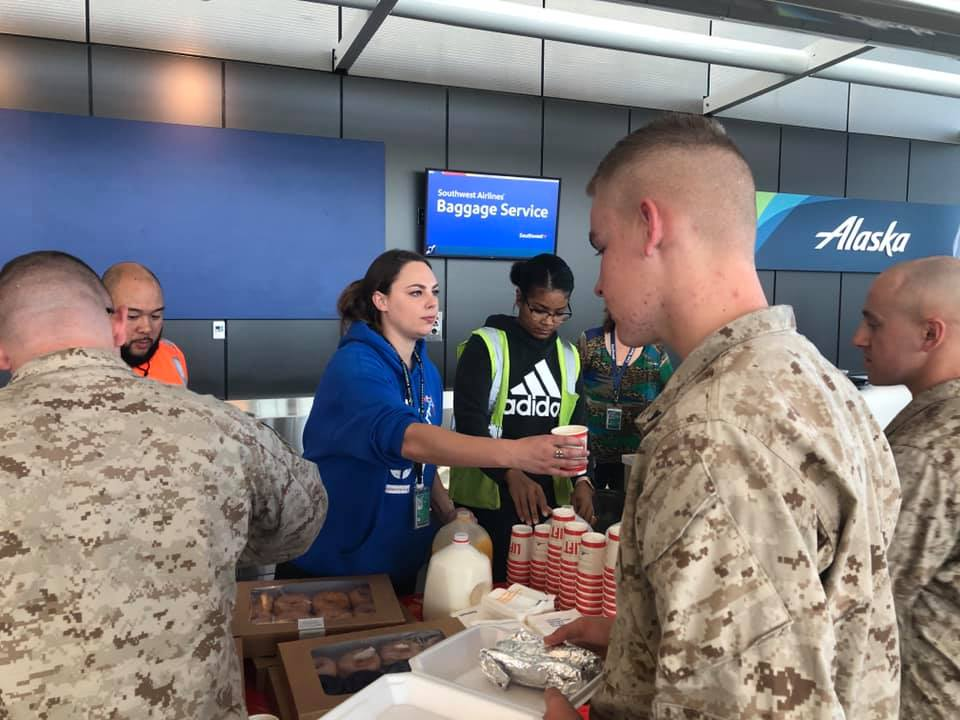 US Army Persons Taking Their Breakfast From Southwest Airlines Employees