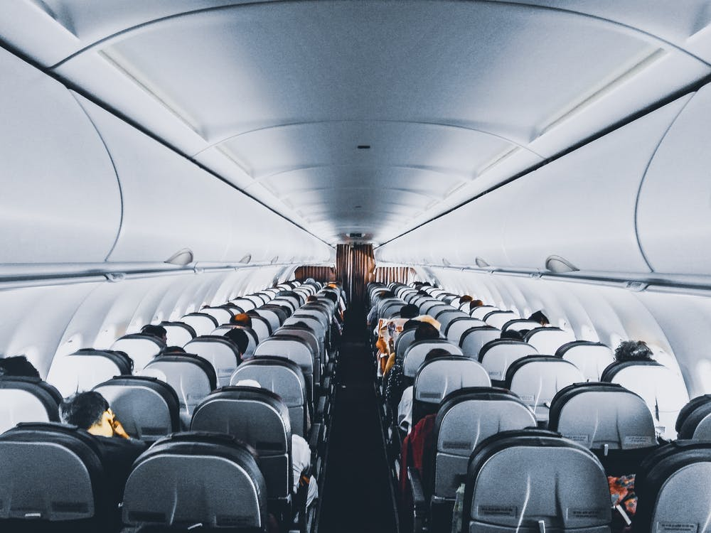 https://www.pexels.com/photo/people-inside-commercial-air-plane-1309644/