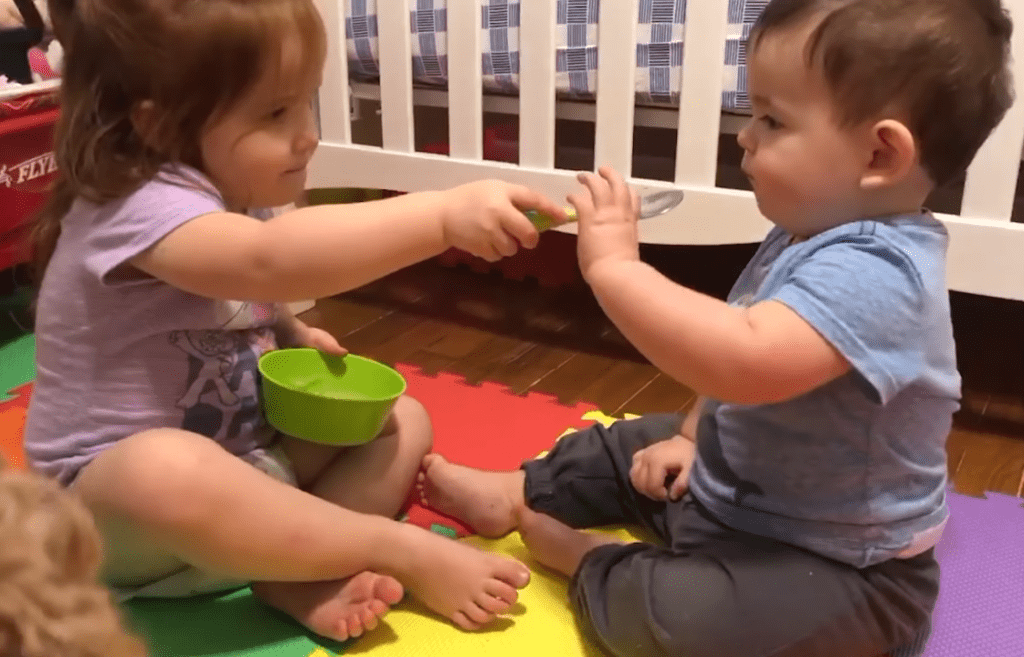 Little Baby Brother Tells Toddler Sister to Give Him Bite