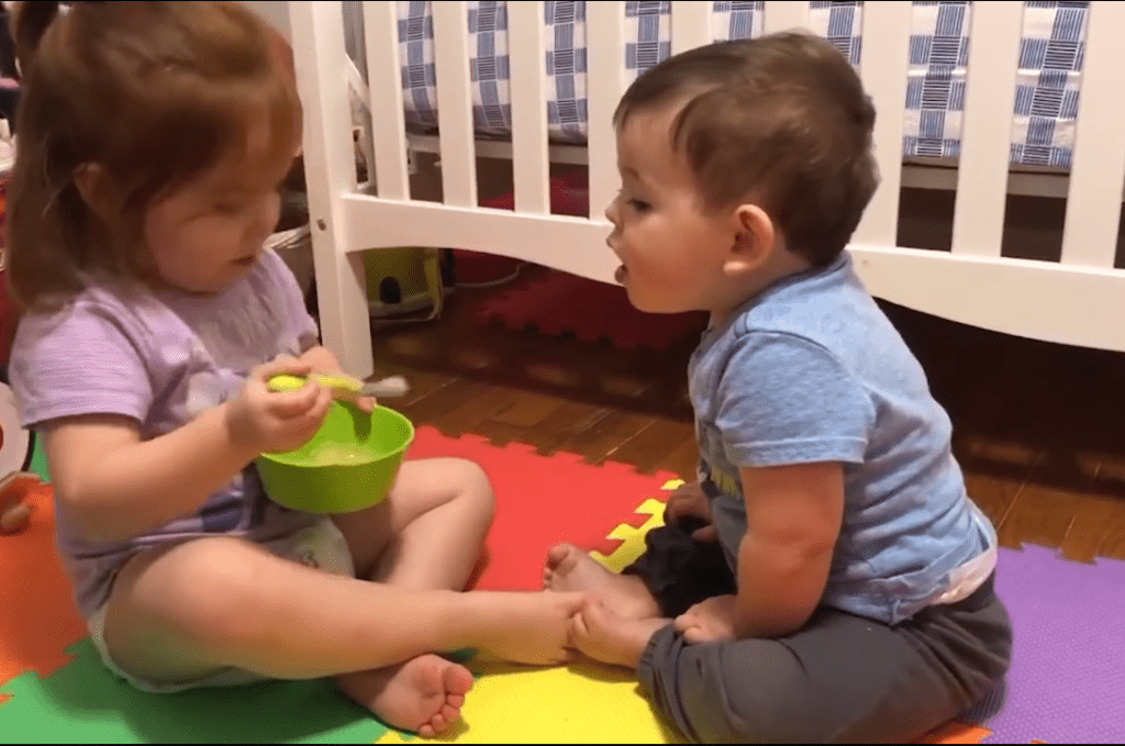 Toddler Sister & Her Baby Brother Enjoying Sweet Moment of Love