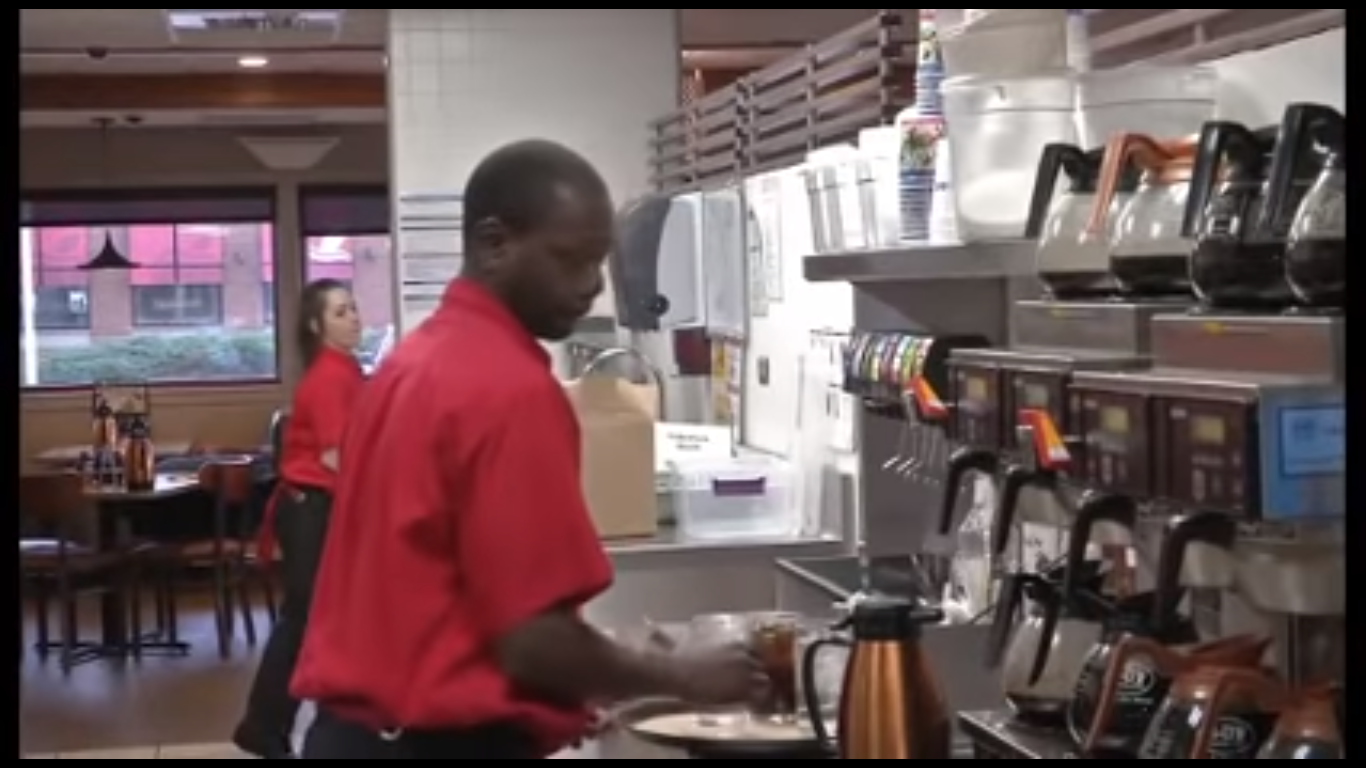 waiter helps feed disabled woman