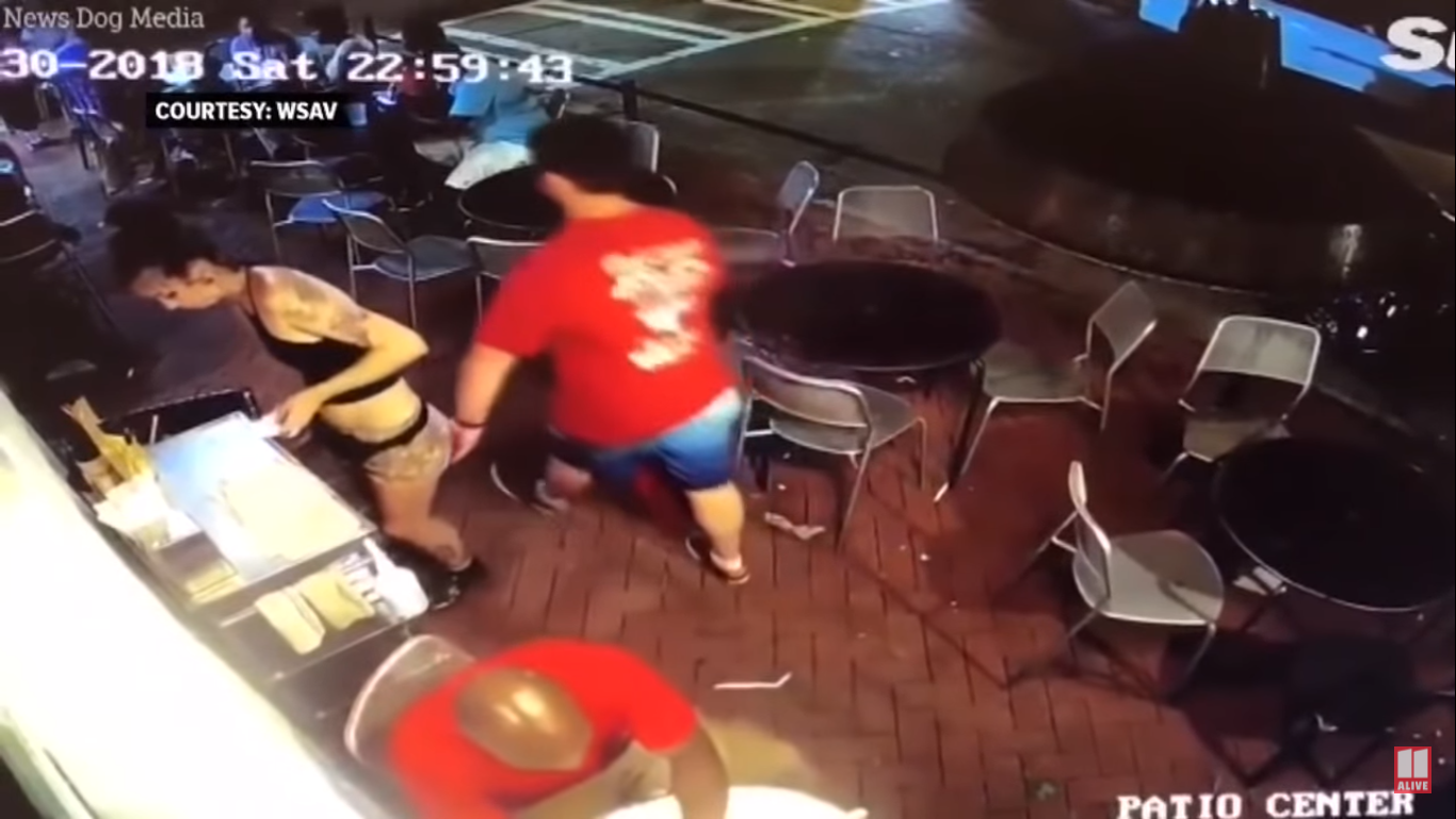 man gropes waitress