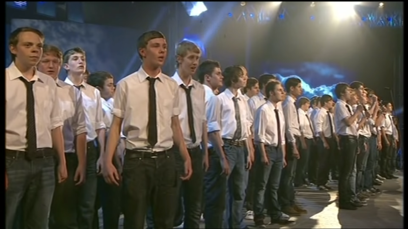 young men's group performs