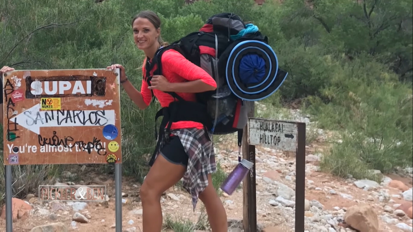 Woman finds injured 55-pound dog alone on mountain and lifts him onto her shoulders