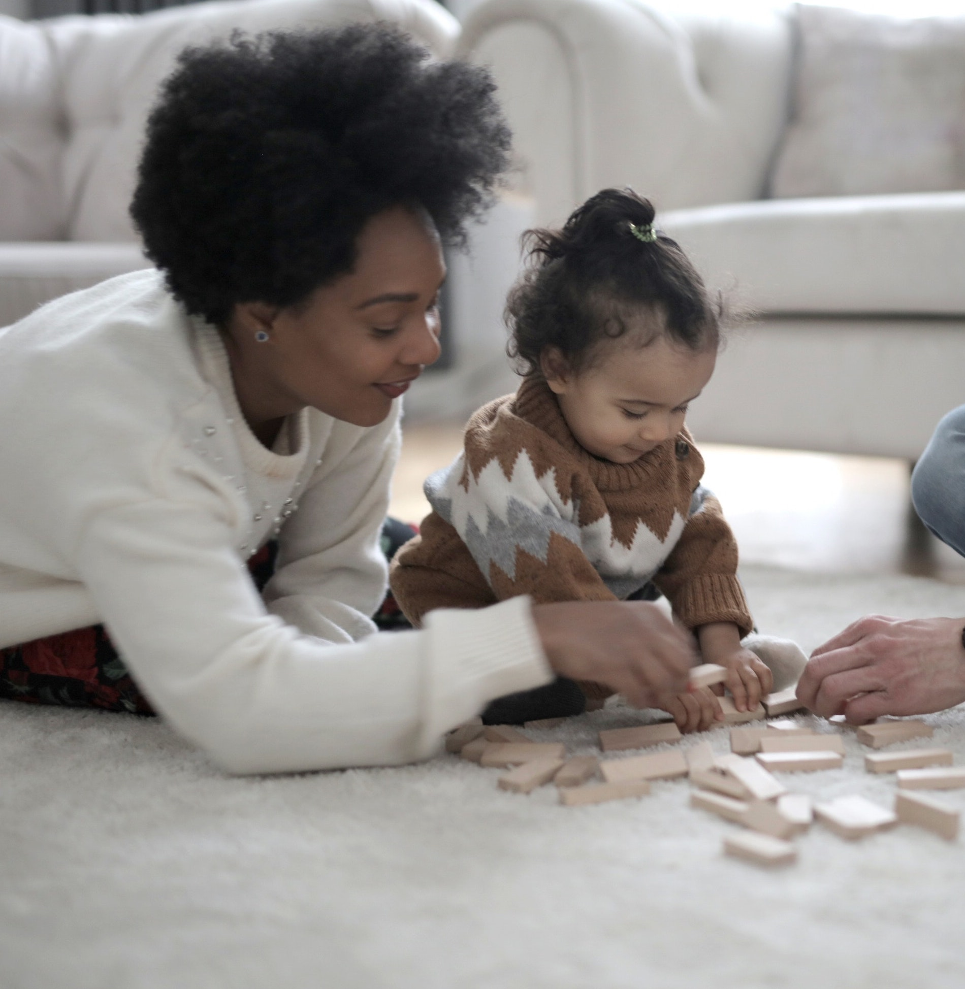 https://www.pexels.com/photo/photo-of-man-and-woman-playing-with-their-child-3819567/